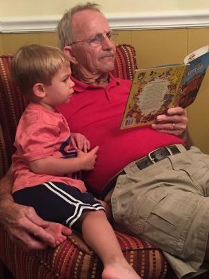 Papa reading books to Turner